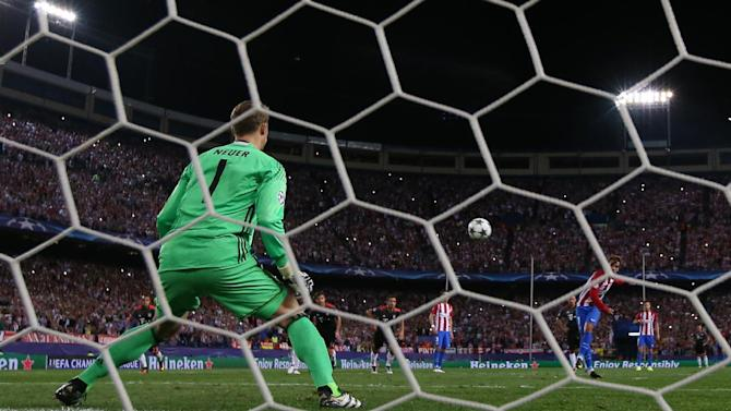 Atletico Madrid's Antoine Griezmann misses from the penalty spot