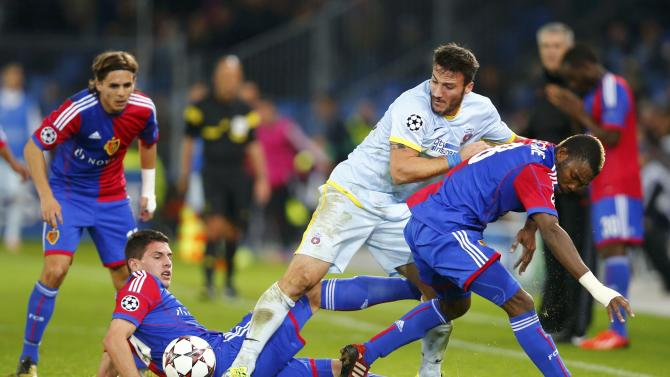 Steaua Bucharest's Piovaccari is challenged by FC Basel players during Champions League soccer match in Basel