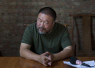 "FILE - In this May 22, 2013 file photo, Chinese artist Ai Weiwei speaks to journalists at his studio in Beijing, China, Wednesday, May 22, 2013. On the second anniversary of his 81-day secret detention, Ai is releasing his first music album ""The Divine Comedy,"" which includes the single ""Dumbass."" The full album, released Saturday, June 22, 2013, has five other songs, in which Ai documents his experiences with police and shares his reflection on China's current conditions.(AP Photo/Alexander F. Yuan, File)"