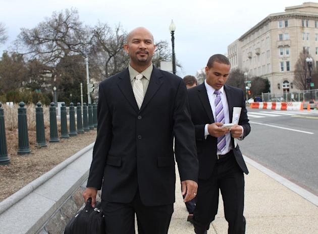 This April 2, 2014 file photo shows former Northwestern University football quarterback Kain Colter, right, and Ramogi Huma, founder and president of the National College Players Association arrive on