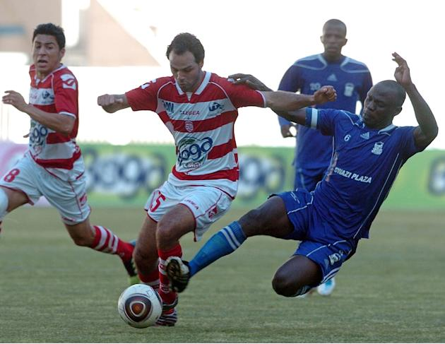 File photo shows defender Gama Jhon (R) of Swaziland's Royal Leopards FC tackling Tunisian Club Africain's striker Zouheir Dhaouadhi during a CAF Confederation Cup match at the Rades Olympic s