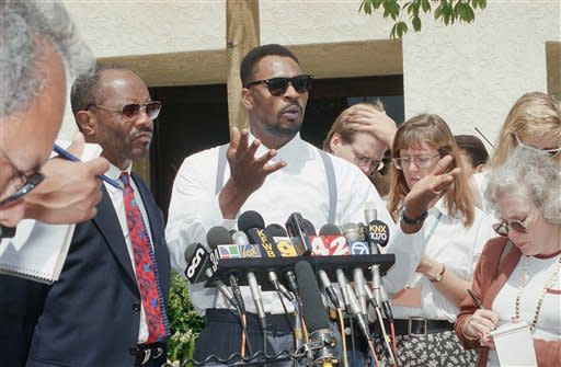This June 2, 1994 file photo shows Rodney King speaking at a news conference in Santa Ana, Calif. along with his attorney Milton Grimes, at left. King, the black motorist whose 1991 videotaped beating