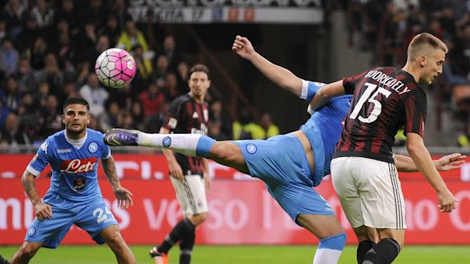 AC Milan's Ely challenges Napoli's Higuain during their Italian Serie A soccer match at the San Siro stadium in Milan