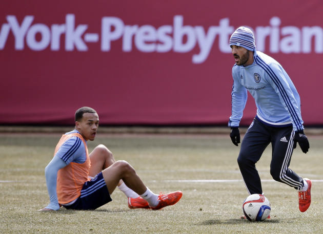 New York City FC's David Villa, right, of Spain, dribbles past a teammate during an open training session at Yankee Stadium, Wednesday, March 25, 2015, in New York. New York City FC host Sporting