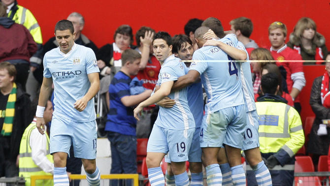 Manchester City's David Silva, centre right, celebrates with teammates after scoring during his team's 6-1 win over Manchester United in their English Premier League soccer match at Old Trafford Stadium, Manchester, England, Sunday Oct. 23, 2011. (AP Photo/Jon Super)