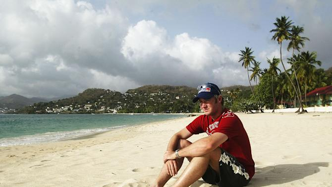 Michael Clarke of Australia sits on the beach