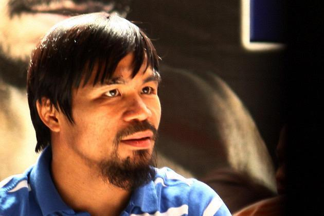 21 November 2011: WBO Welterweight World Champion and Sarangani Rep. Manny Pacquiao arrived at the Midas Hotel in Pasay City, south of Manila. (Marlo Cueto/NPPA Images)