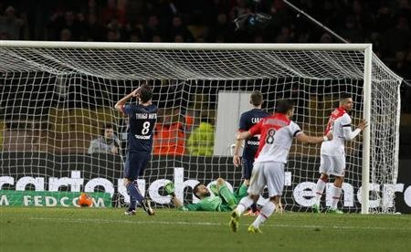 Paris Saint-Germain's Thiago Silva scores against his camp during their French Ligue 1 soccer match against Monaco at the Louis II stadium in Monaco, February 9, 2014. REUTERS/Jean-Paul Pelissier
