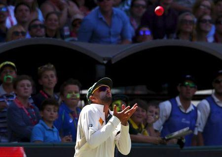 Australia's Nathan Lyon prepares to take a catch to dismiss New Zealand's Tim Southee for 13 runs during the third day of the third cricket test match at the Adelaide Oval, in South Australia