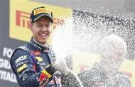 Red Bull Formula One driver Sebastian Vettel of Germany sprays champagne on the podium after winning the Italian F1 Grand Prix at the Monza circuit September 8, 2013. Vettel won the Italian Grand Prix at a canter on Sunday, leading from pole position to celebrate his 32nd career win and third at Monza. REUTERS/Stefano Rellandini