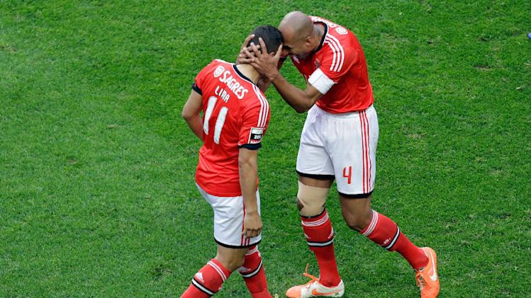 Benfica's Lima, from Brazil, left, celebrates with teammate Luisao, also from Brazil, after scoring the opening goal against Olhanense during their Portuguese league soccer match, Sunday April 20, 2014, at Benfica's Luz stadium in Lisbon