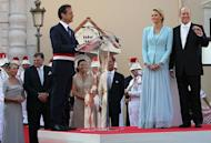 The Mayor of Monaco Georges Marsan (3rdL) delivers a speech in honor of Prince Albert II of Monaco and Princess Charlene of Monaco after their civil wedding as Charlene's parents Lynette Humberstone (L) and Michael Kenneth Wittstock look on at the Prince's Palace