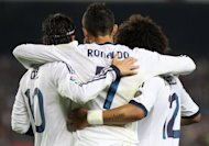 Real Madrid's Cristiano Ronaldo (C) celebrates with his teammates after scoring during their Spanish La Liga match against Barcelona at the Camp Nou stadium in Barcelona, on October 7. Real are battling an injury crisis ahead of their home clash with Celta Vigo on Saturday as World Cup duty threatens the team's La Liga pursuit of bitter rivals Barca
