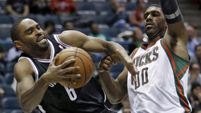 Lopez leads Nets to 90-82 win at Bucks