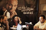 Egyptian campaign managers for presidential candidate Ahmed Shafiq work at his campaign headquarters in Cairo. Egypt looks set for a run-off presidential vote between the Muslim Brotherhood's Mohammed Mursi and Shafiq, pitting the Islamists who helped oust a dictator against his last premier