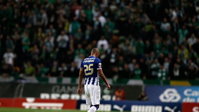 Porto's Fernando leaves the pitch after being sent off by the referee during their Portuguese league soccer match with Sporting Sunday, March 16 2014, at Sporting's Alvalade stadium in Lisbon. Sporting won 1-0