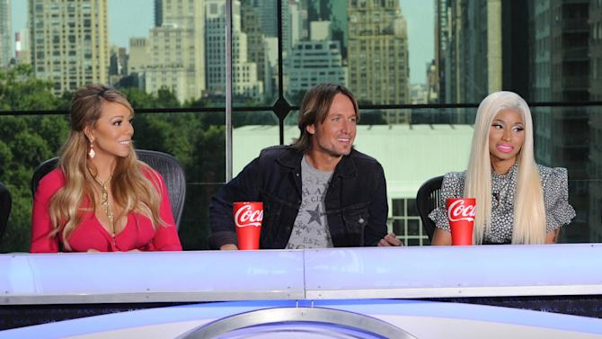 "FILE - ThisSept. 17, 2012 file image released by Fox shows the new judges for the singing competition series, ""American Idol,"" from left, Mariah Carey, Keith Urban and Nicki Minaj and during a news conference in New York. Host Ryan Seacrest said Wednesday, Oct. 3, that things got intense between new judges Nicki Minaj and Mariah Carey during a tryout taping in Charlotte, N.C., the day before. In the midst of a dispute over a contestant, Minaj announced that she was no longer putting up with ""her ... highness,"" a reference to Carey with a few expletives added in. Another new judge, Keith Urban, was in the unenviable position of sitting between them. (AP Photo/FOX, Michael Becker)"
