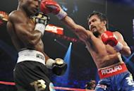 Manny Pacquiao (right) of the Philippines fights Timothy Bradley (left) of the US for the WBO welterweight title at the MGM Grand Arena on June 9 in Las Vegas. Pacquiao's stunning and controversial loss in the match has sparked furious demands in the Philippines - led by his mother on Monday - for a rematch