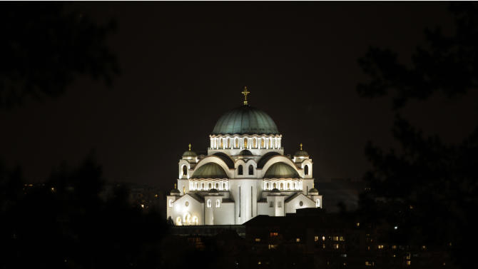 In this combo of two photos illuminated St. Sava Serbian temple, largest Orthodox church in the Balkan regions, top, and a picture of the temple with most of its lights turned off, in Belgrade, Serbia, Saturday, March 23, 2013. Organised by the World Wide Fund for Nature, earth hour is observed every year to create awareness about conservation of energy and climate change. Around the world, people and organisations will be turning their lights off from 8:30 to 9:30 pm local time. (AP Photo/Darko Vojinovic)