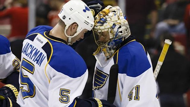 St. Louis Blues goalie Jaroslav Halak (41) receives congratulations from St. Louis Blues defenseman Barret Jackman (5) (Reuters)