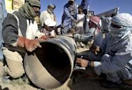 Pakistani employees of natural gas repair a damaged pipeline in 2006. Turkmenistan said Saturday that it would try to recruit international investors for a new gas pipeline project that would link Central and South Asia