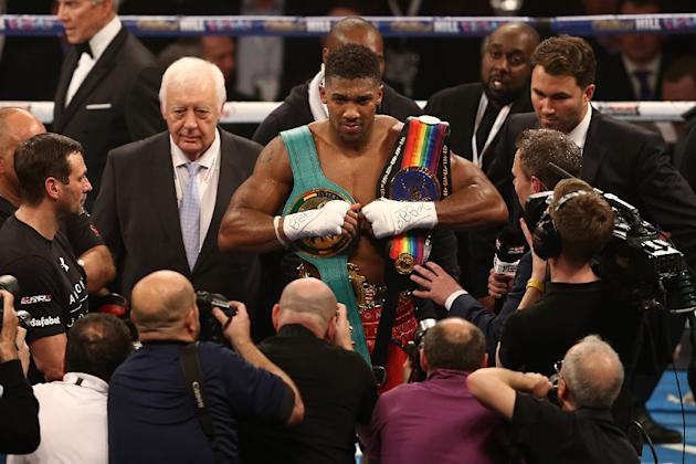 British boxer Anthony Joshua (C), seen in London on December 12, 2015, is one of the most highly-rated young fighters in boxing, having built up a perfect record of 15 knock-outs from 15 fights