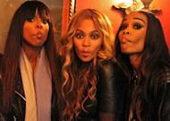 Kelly Rowland, Beyonce and Michelle Williams of Destiny's Child pucker up for the camera --