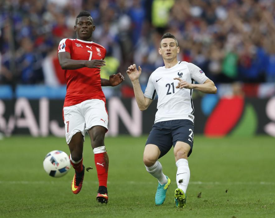 Switzerland's Breel Embolo in action with France's Laurent Koscielny