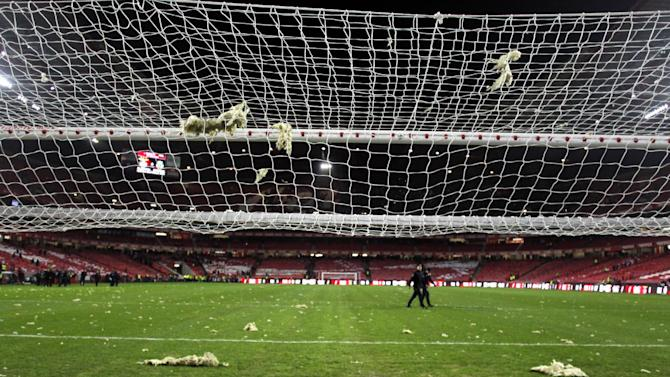 Pieces of debris fallen from the roof of the stadium rest over the pitch and the goal's net, prior the Portuguese league soccer match between Benfica and Sporting at Benfica's Luz stadium, in Lisbon, Sunday, Feb. 9, 2014. Strong winds damaged the stadium roof before kick off and debris fell on the pitch and stands. It was decided the match should be postponed for security reasons