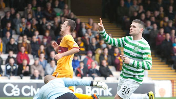 Celtic's Gary Hooper, right, celebrates scoring his side's first goal against Motherwell