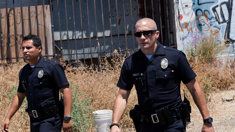 "This film image released by Open Road Films shows Michael Pena, left, and Jake Gyllenhaal in a scene from ""End of Watch."" (AP Photo/Open Road Films, Scott Garfield)"