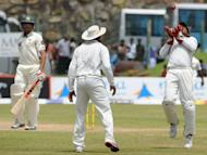 Sri Lankan wicketkeeper Prasanna Jayawardene (R) makes the catch to dismiss Pakistan batsman Umar Gul (L) during the third day of their opening Test match on June 24. Sri Lanka turned the screws on Pakistan in the first cricket Test in Galle, bowling the tourists out for 100 on the third day on Sunday