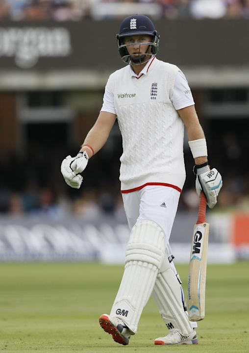England's Joe Root leaves the pitch  after being caught by Trent Boult off the bowling of New Zealand's Matt Henry during the fourth day of the first Test match between England and New Zealand