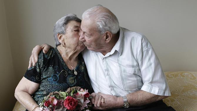 Madalena, 88, and Fortunato Corso, 89, a Bensonhurst couple married 72 years prepare for Valentine's Day with a kiss at home in New York, Wednesday, Feb. 13, 2013.  On Thursday they'll be honored by Brooklyn borough President Marty Markowitz in a celebration of couples married 50 years or more.  The Corso's, who met as teenagers in Calabria, Italy, and married Feb. 4, 1941, have seven children, three girls and four boys. (AP Photo/Kathy Willens)