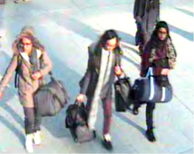 FILE -  In this still taken from CCTV issued by the Metropolitan Police in London on Feb. 23, 2015,  15-year-old Amira Abase, left,  Kadiza Sultana,16, center, and Shamima Begum, 15, walk through Gatw