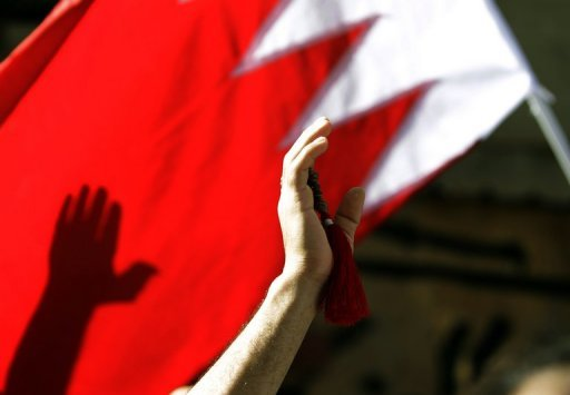 A Shiite protester waves a Bahrain flag during a rally in Manama, on March 22, 2011. A Bahraini appeals court has confirmed the acquittal of a policewoman on trial for torturing a journalist arrested during Shiite-led unrest in the Gulf kingdom two years ago, judicial sources said
