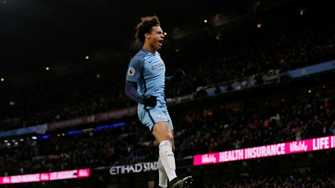 Manchester City's Leroy Sane celebrates scoring their first goal