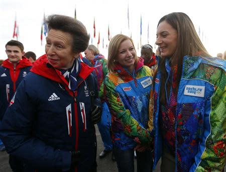 Britan's Princess Anne talks with Russian pole vaulter and Mayor of the Coastal Cluster Olympic Village Isinbayeva, during the welcoming ceremony for British Olympic team in the Athletes Village