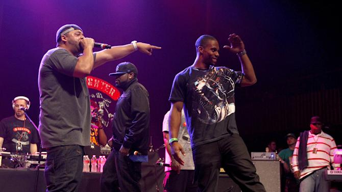 Joell Ortiz of Slaughter House, left, introduces New York Giants wide receiver Victor Cruz, right, during the 'Fuse Live: Shady 2.0' SXSW concert at the Austin Music Hall on Friday, March 16, 2012 in Austin, Texas. (Brandon Wade/AP for Fuse)
