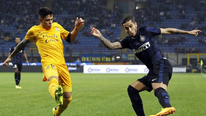 Inter Milan's Alvarez fights for the ball with Hellas Verona's Romulo during their Italian Serie A soccer match in Milan