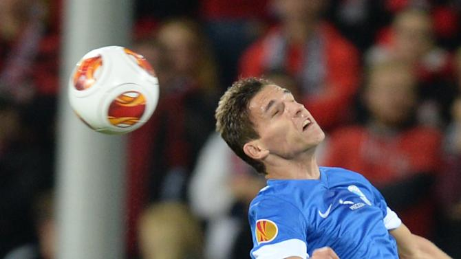 Admir Mehmedi , left,  of Freiburg and David Pavelka  of Liberec vie for the ball during the UEFA Europa League Group H soccer match between SC Freiburg and Slovan Liberec FC  in Freiburg, Germany, Thursday Sept. 19,  2013