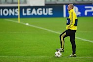 Chelsea's Italian coach Roberto Di Matteo supervises training at the Juventus Stadium in Turin on the eve of his team's UEFA Champions league match against Juventus