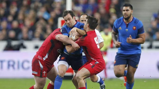 France's Parra attempts to evade the tackle of Wales' Lee and Webb during their Six Nations rugby union match at the Stade de France stadium in Saint-Denis, near Paris
