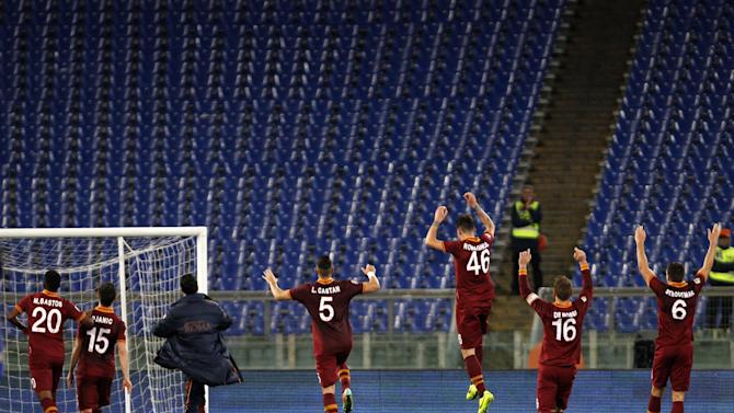 AS Roma players celebrate at the end of a Serie A soccer match between AS Roma and Sampdoria, at Rome's Olympic stadium, Sunday, Feb. 16, 2014. AS Roma won 3-0