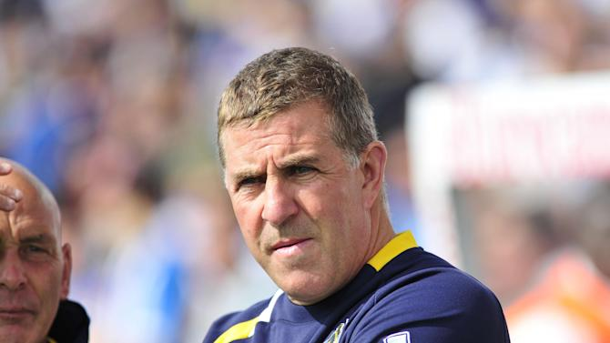 Bristol Rovers manager Mark McGhee is eyeing two strikers