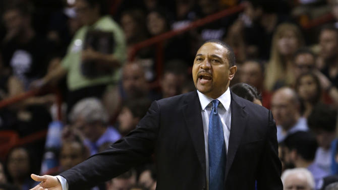 Golden State Warriors coach Mark Jackson gestures during the first half of an NBA basketball game against the Miami Heat, Thursday, Jan. 2, 2014, in Miami. (AP Photo/Lynne Sladky)