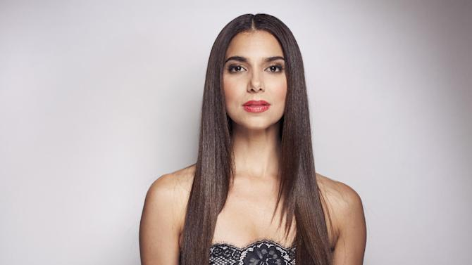 "This June 19, 2013 photo shows actress Roselyn Sanchez in New York. Sanchez stars in the series, ""Devious Maids,"" airing Sundays at 10 p.m. EST on Lifetime. (Photo by Taylor Jewell/Invision/AP)"