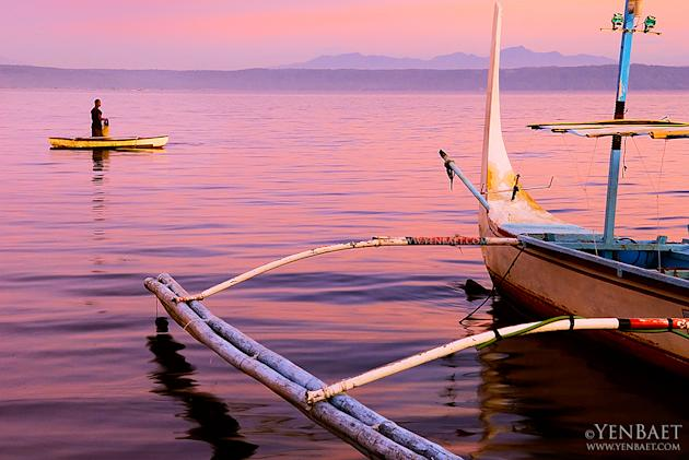 The sun sets on fishermen on Taal Lake. The lake is known for the maliputo and tawilis harvested from the waters. (Yen Baet)