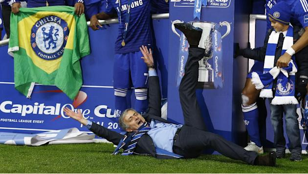 FILE - In this Sunday, March 1, 2015, file photo, Chelsea's head coach Jose Mourinho lies on the ground as he celebrates his team winning the English League Cup final soccer match between Chelsea