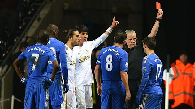 Chelsea's Belgium midfielder Eden Hazard (R) is sent off by referee Chris Foy after an incident involving a ballboy during the English League Cup semi-final second leg football match between Swansea City and Chelsea at The Liberty stadium (AFP)
